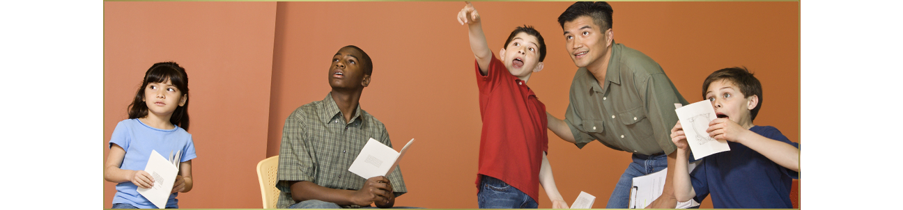 Children taking an acting class.